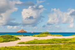 Tropical beach, sand, sea, palapas and sky Stock Image