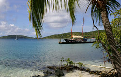 Tropical beach scene. Scenic view of tropical beach with boat moored at jetty, Bitter End resort, Virgin Gouda island, British Virgin islands Stock Photography