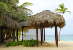 Tropical beach scene. Image of a resort and spa on a tropical beach Stock Images