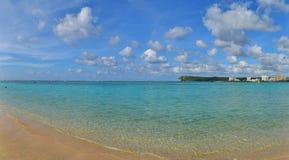 Tropical Beach Scene. Ocean meeting the beach on a tropical island Royalty Free Stock Photo