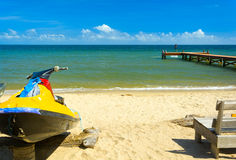 Tropical beach scene. With personal water craft Royalty Free Stock Photography