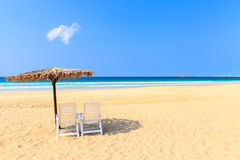 Tropical beach scenery with parasol and deck chairs in Boavista, Stock Images
