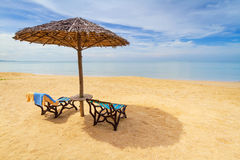 Tropical beach scenery. With parasol and deck chairs in Thailand Royalty Free Stock Photography