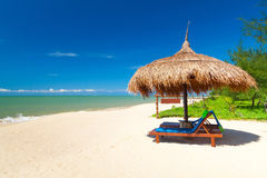Tropical beach scenery with parasol Stock Image