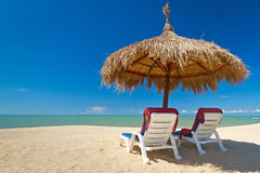 Tropical beach scenery with parasols. In Thailand Royalty Free Stock Images