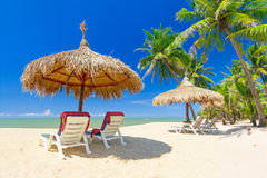 Tropical beach scenery in Thailand. Tropical beach scenery with parasol and deck chairs in Thailand Stock Image