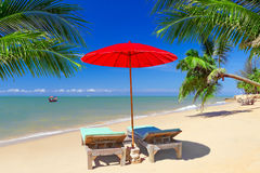 Tropical beach scenery in Thailand. Tropical beach scenery with parasol and deck chairs in Thailand Royalty Free Stock Photos