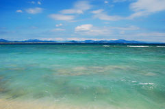 Tropical beach and sea. Scenic view of tropical beach and turquoise sea with blue sky and cloudscape background, Sanya, China Stock Photography