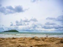 Tropical beach and sea on blue sky. Beautiful tropical beach and sea on blue sky background Stock Photo