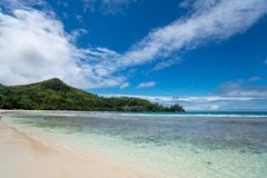 Tropical beach with sea and palm . Beach and sea photo. Romantic beach aerial view. Seychelles.  stock photography
