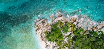 Tropical beach with sea and palm taken from drone. Anse Lazio beach at Praslin island, Seychelles. Vacation holidays concept.  stock photo
