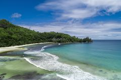 Tropical beach with sea and palm taken from drone. Beach and sea photo. Romantic beach aerial view.  stock photo