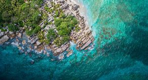 Tropical beach with sea and palm taken from drone. Seychelles famous shark beach - aerial photo royalty free stock images