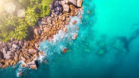 Tropical beach with sea and palm taken from drone. Seychelles famous shark beach - aerial photo.  royalty free stock photos