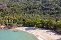 Tropical beach and sea water waves on island Koh Phangan, Thailand. KOH PHANGAN, THAILAND - MARCH 15, 2018 : Than Sadet beach and sea water waves. Koh Phangan Stock Photo