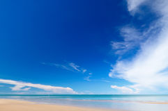 Tropical beach and sea. Tropical beach with white sand, fresh turquoise sea, deep blue sky and white clouds in Pranburi, Thailand stock photography