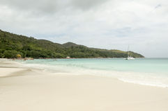 Tropical beach at Seychelles - nature background. Anse Lazio beach, Praslin Island, Seychelles. Cloudy day Stock Photos