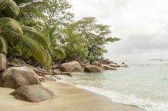Tropical beach at Seychelles - nature background. Anse Lazio beach, Praslin Island, Seychelles. Cloudy day Stock Image