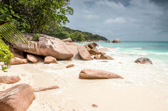 Tropical beach at Seychelles - nature background. Anse Lazio beach, Praslin Island, Seychelles. Cloudy day Stock Images