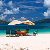 Tropical beach at Seychelles with picnic table Royalty Free Stock Images