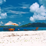 Tropical beach at Seychelles with picnic table Stock Images