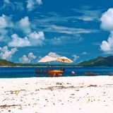 Tropical beach at Seychelles with picnic table Royalty Free Stock Photos