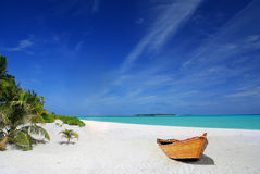 Tropical beach and ship Stock Images