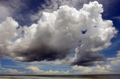 Tropical beach sky-scape. Majestic fluffy cloud formation over a tropical sea stock photography