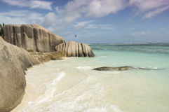 Tropical beach Source D'Argent at island La Digue, Seychelles - vacation background. View on untouched tropical beach with boulders rocks, turquoise ocean and Stock Photos