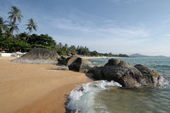 Tropical beach with stones Stock Images