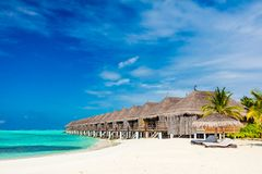 Tropical beach with straw cabins on Maldives royalty free stock images