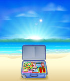 Tropical beach with Suitcase Stock Image