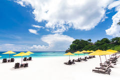 Tropical beach. With sun umbrellas Stock Images