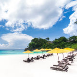 Tropical beach. With sun umbrellas Stock Photo