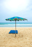 Tropical beach with sunbeds and umbrella Stock Image