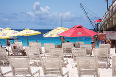 Tropical beach with sunbeds Royalty Free Stock Photo