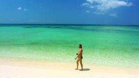 Tropical beach in sunny day on the island and. Tropical beach in sunny day on the island  and walking man. Footage stock video