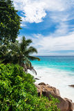 Tropical beach on the sunny day. Photo of a tropical beach on the sunny day Royalty Free Stock Photos