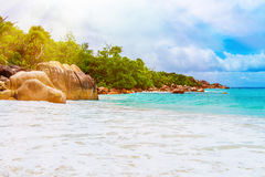 Tropical beach on the sunny day. Photo of a tropical beach on the sunny day. Toned image Royalty Free Stock Photos