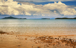 Tropical Beach. Sunny beach and islands on horizon, Thailand Royalty Free Stock Photography