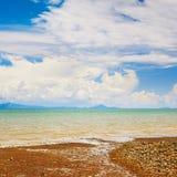 Tropical Beach. Sunny beach and islands on horizon, Thailand Royalty Free Stock Photos