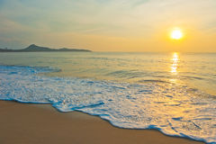 Tropical beach at sunrise Royalty Free Stock Image