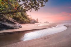 Tropical beach at sunrise. Beautiful beach with river and colorful sky at sunrise or sunset, Thailand Stock Photography