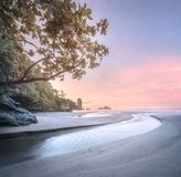 Tropical beach at sunrise. Beautiful beach with river and colorful sky at sunrise or sunset, Thailand royalty free stock photos