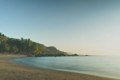 Tropical Beach Sunrise. Early morning at a empty tropical beach. Location Costa Rica Montezuma Stock Photos