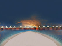 Tropical Beach Sunset. Tropical Beach with Bungalows and blue sky Royalty Free Stock Photo