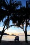 Tropical beach at sunset Stock Photos