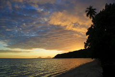 Tropical beach at sunset. Huahine, French polynesia Royalty Free Stock Image