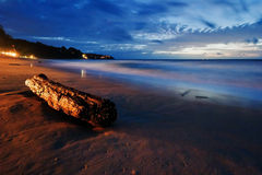 Tropical beach after sunset in beach lights. Royalty Free Stock Image