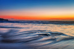 Tropical beach at sunset. Stock Photo